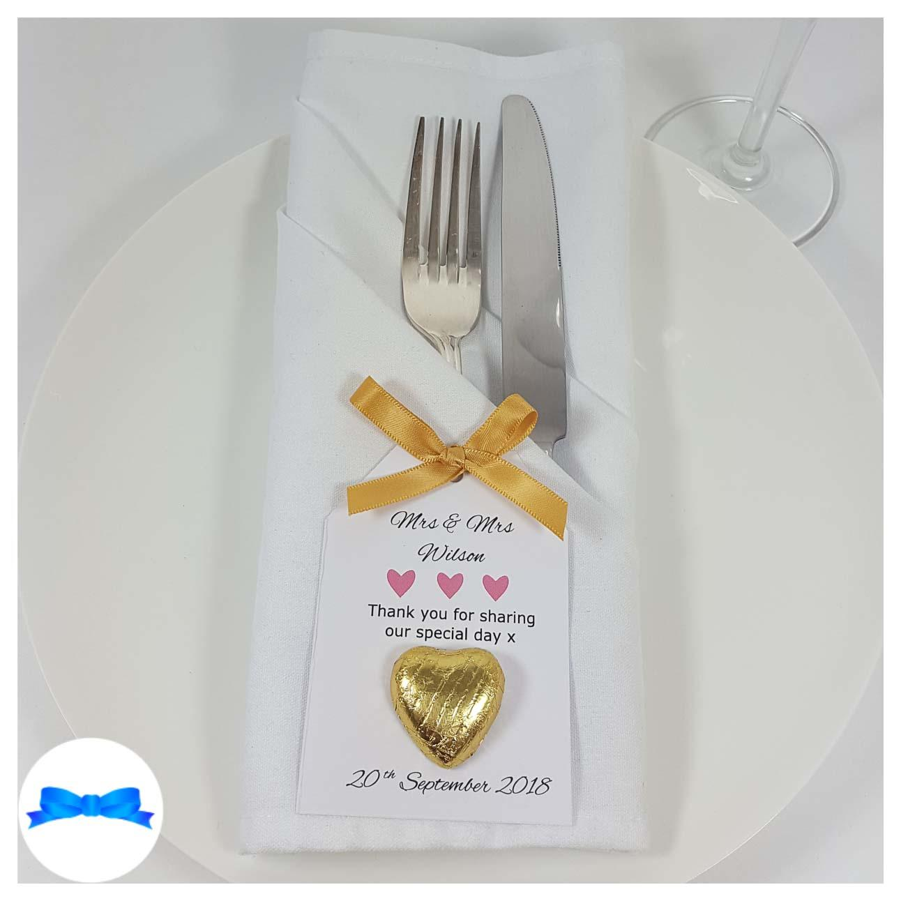 Wedding favour on a plate gold bow and favour