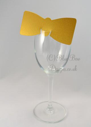 Gold bow tie wine glass place card