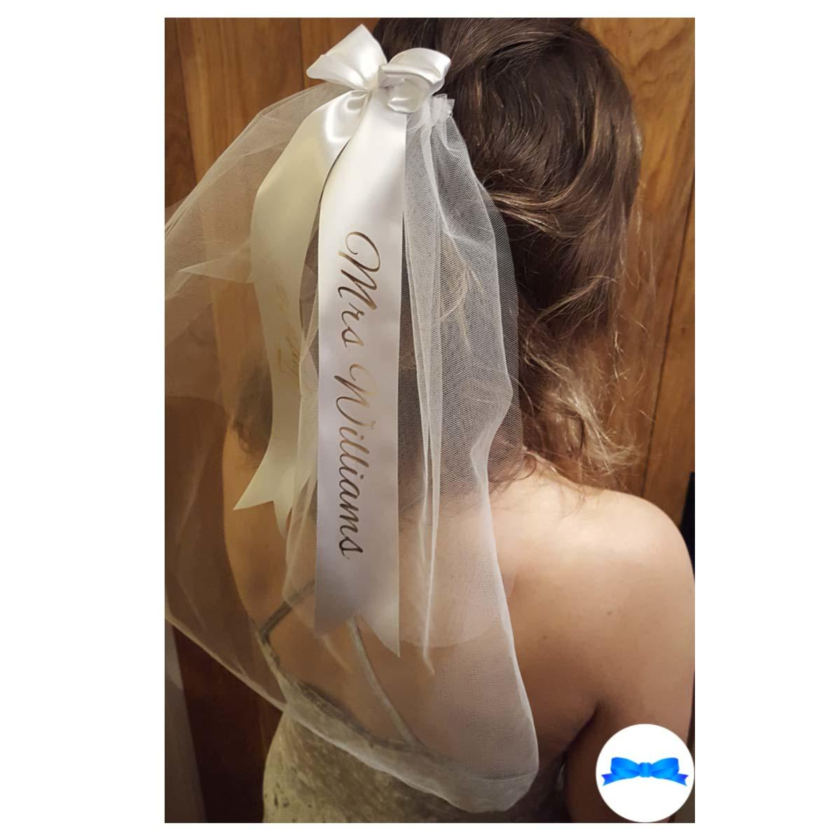 White and gold hen party veil