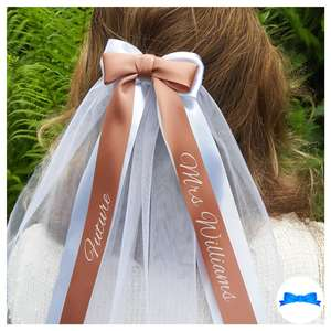 Rose gold and white hen party veil with white print on rose gold ribbon