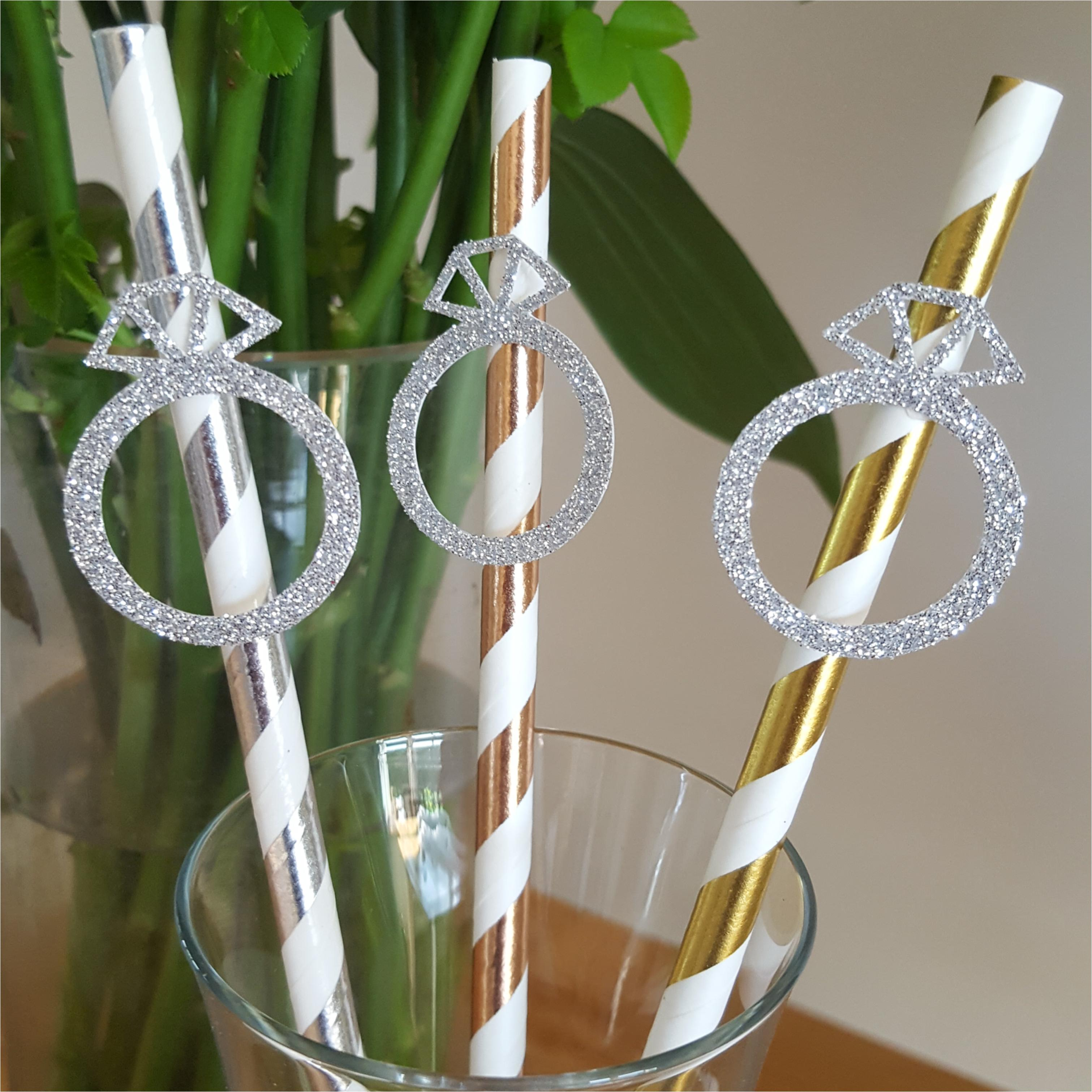 Gold rose, gold and silver glitter diamond ring on straws