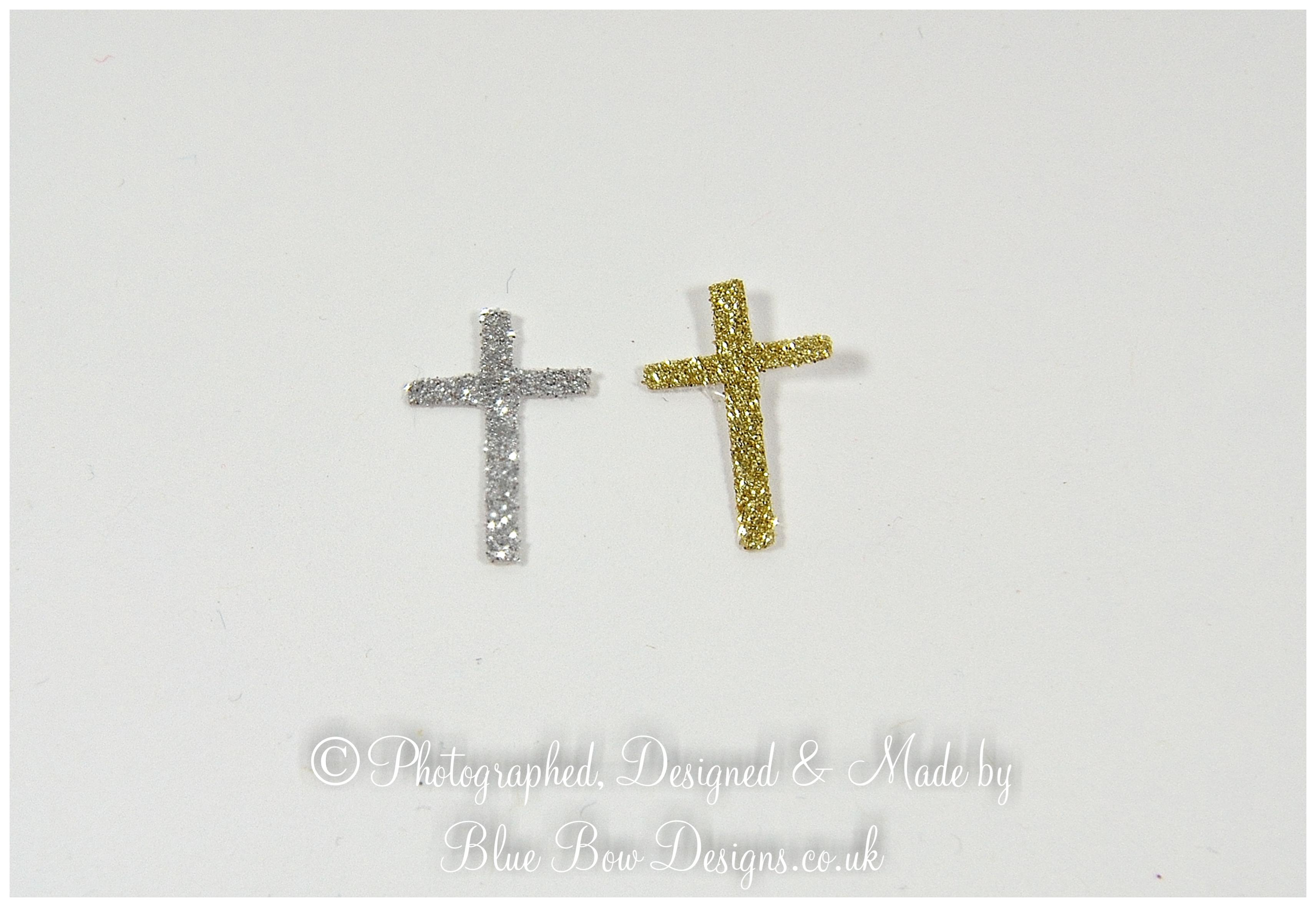 silver and gold cross