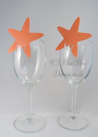 Burnt orange pointed star wine glass place cards