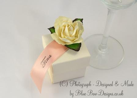 Personalised guest name rose. Peach ribbon