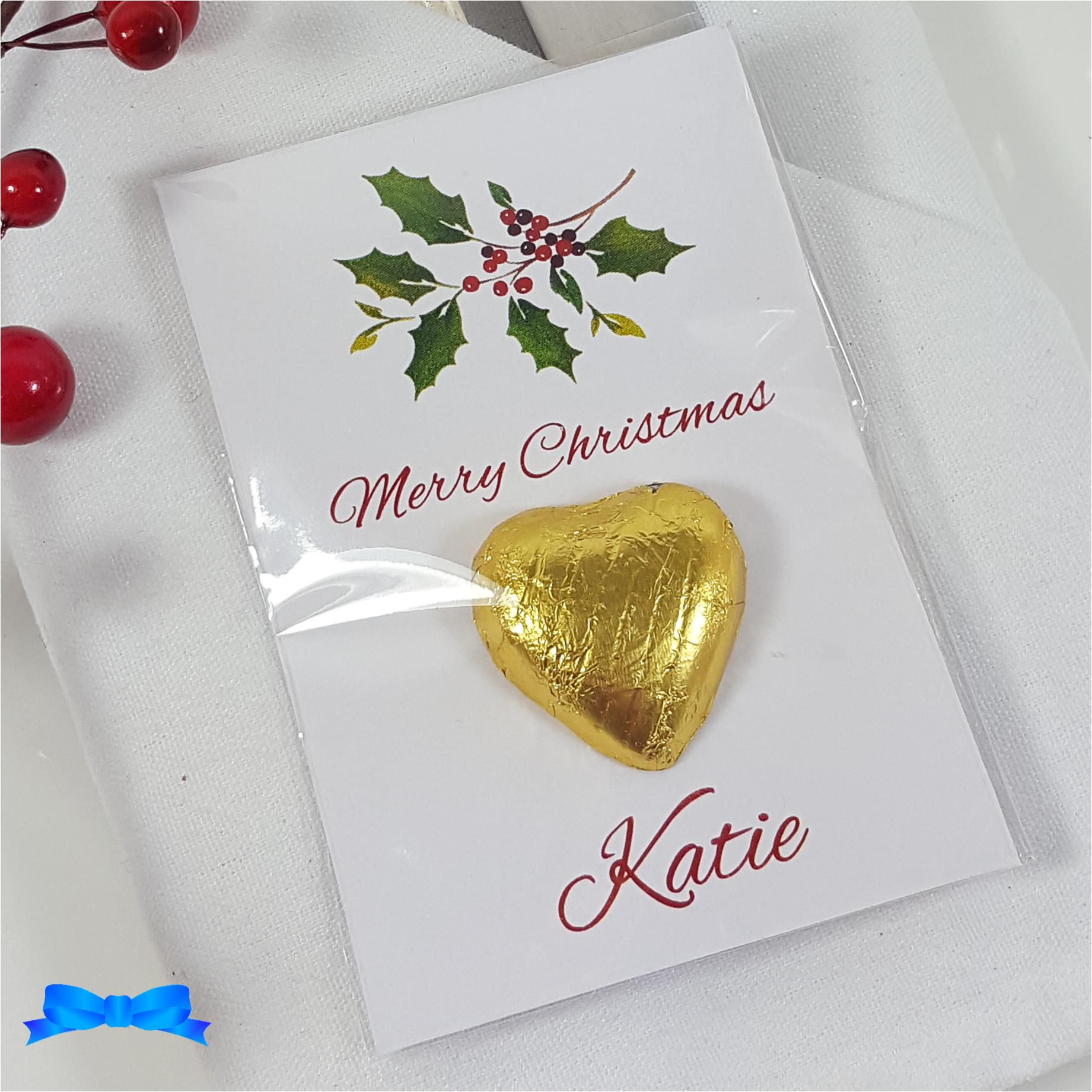 Christmas table favour with holly and gold chocolate heart