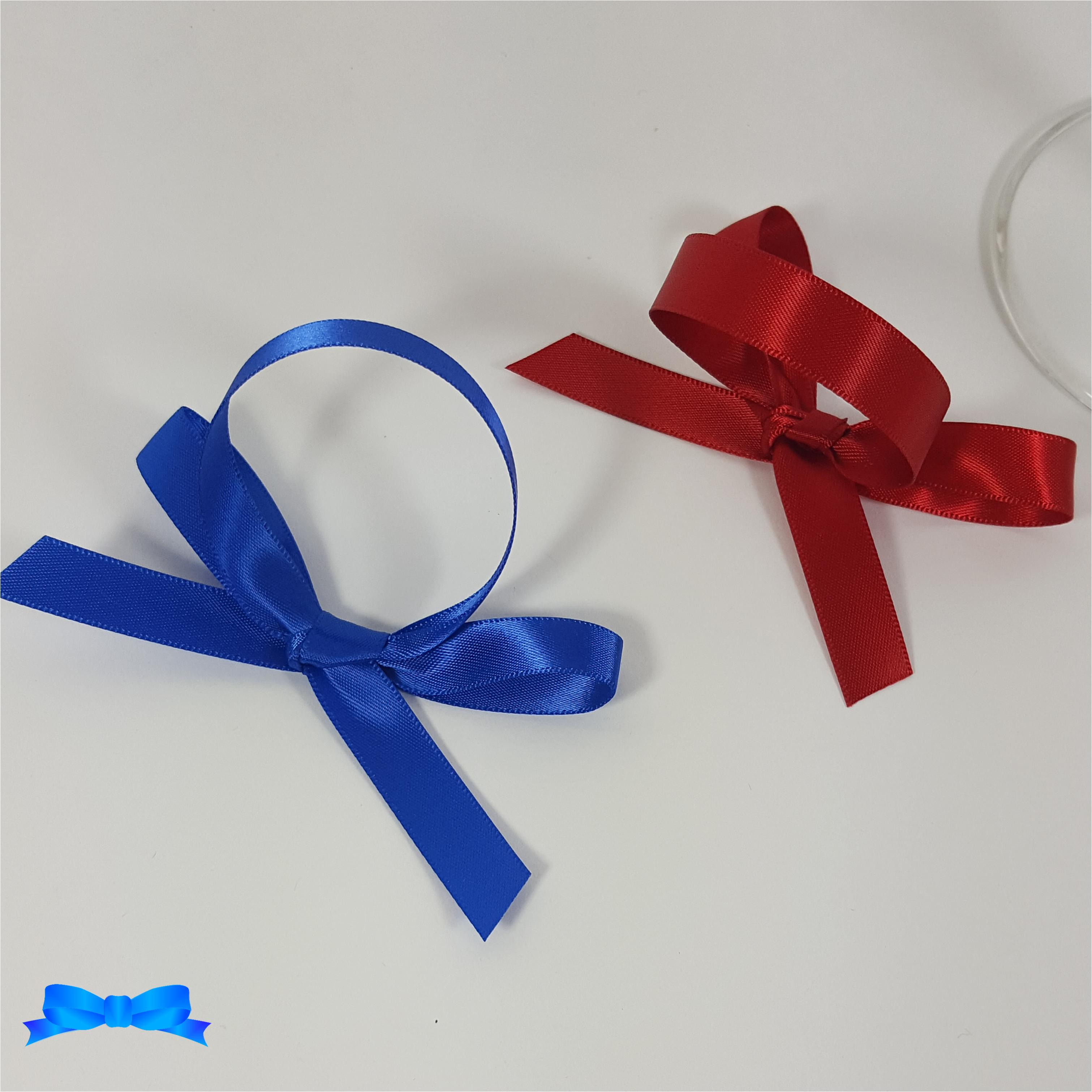Royal blue and red 10 mm scroll bows