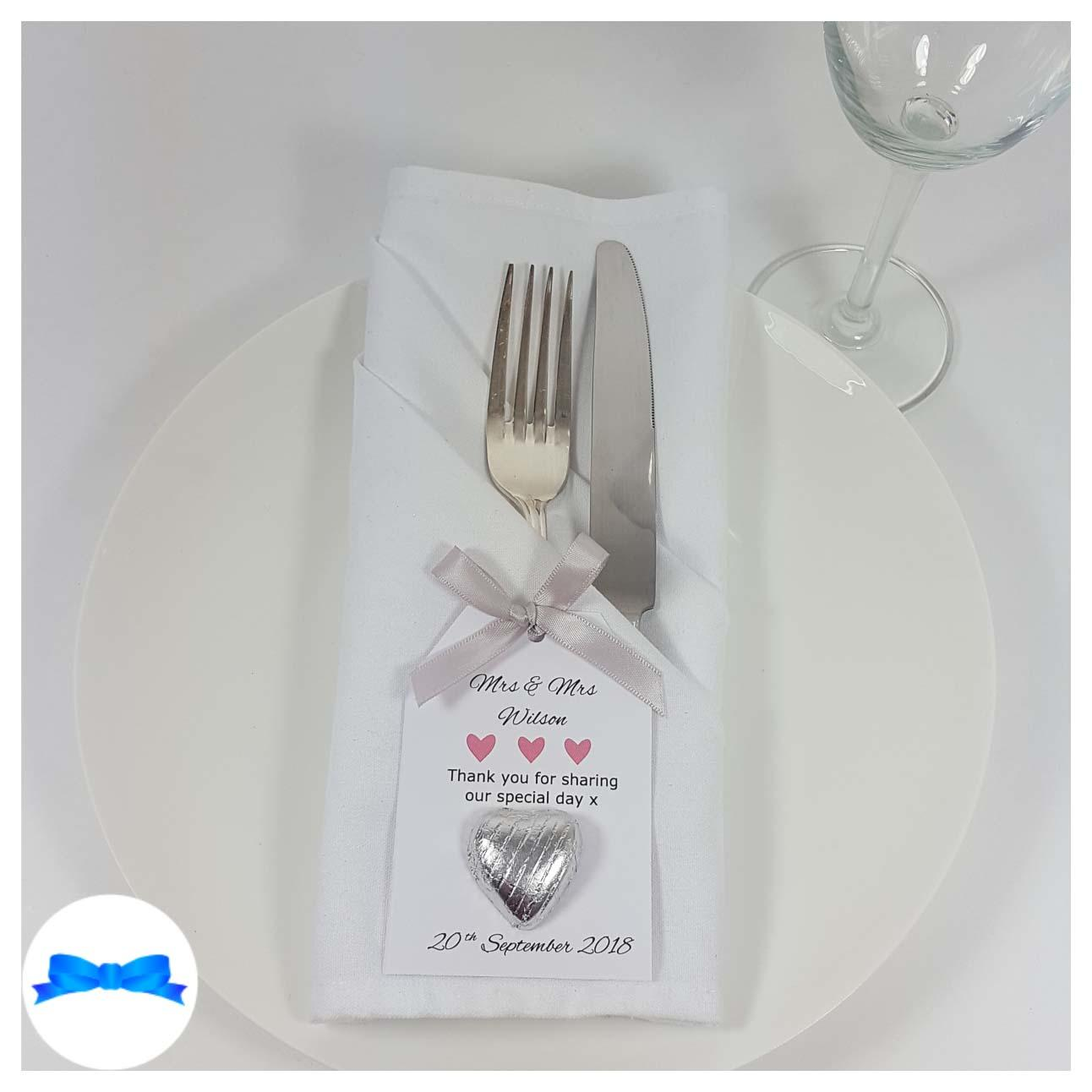 Wedding favour on a plate silver bow and favour