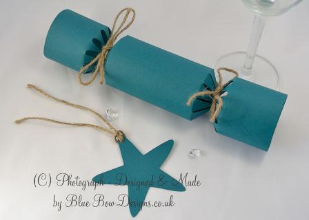 Star shaped teal tag with hessian string