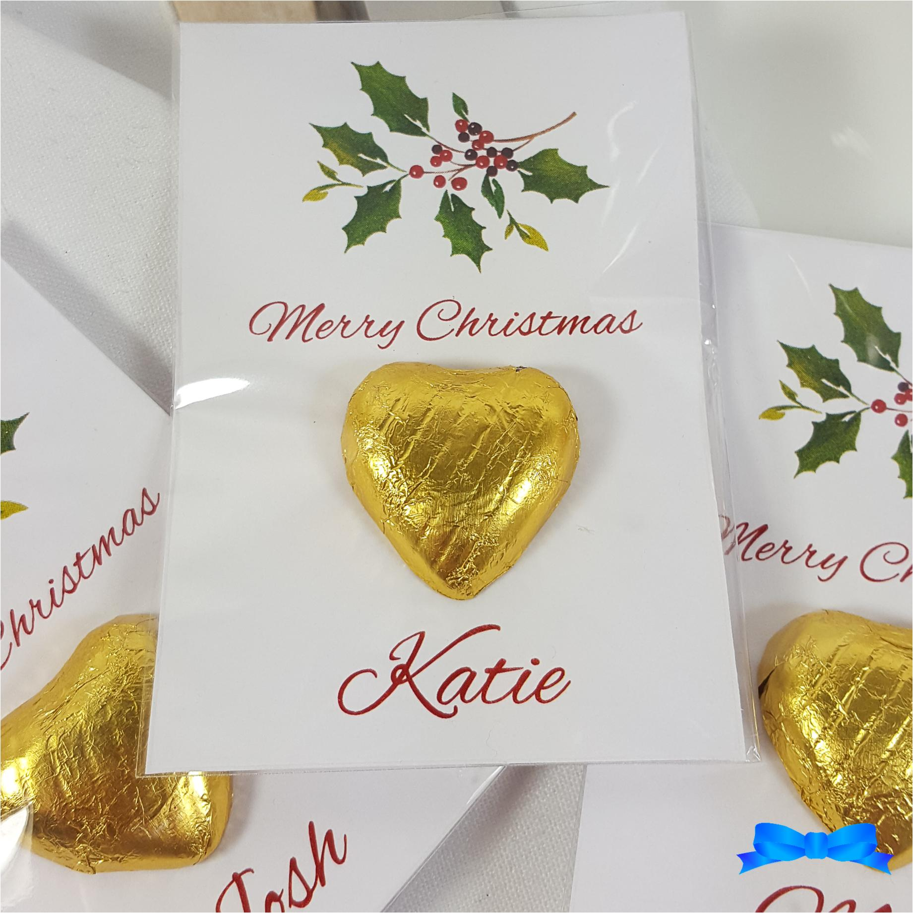 Christmas table favour with holly and gold chocolate hearts