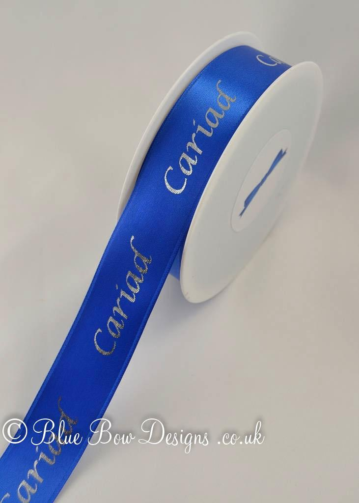 25mm Royal blue printed ribbon on a roll
