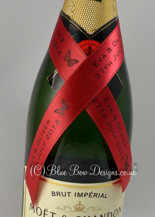 Red and black printed ribbon on bottle