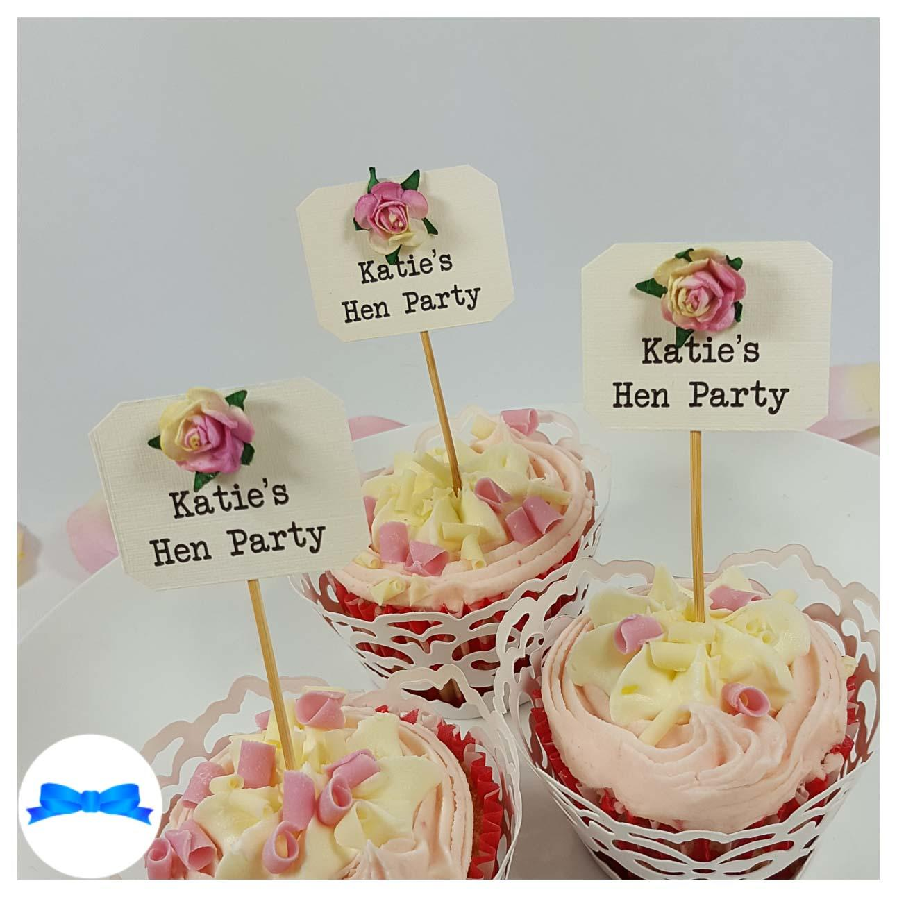 Hen party cupcake toppers with pink and cream roses