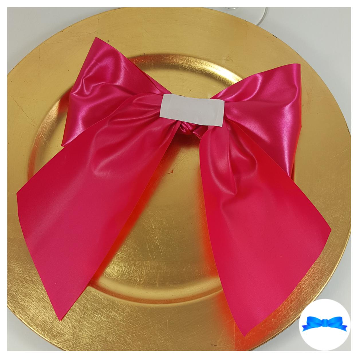 Back of large fuchsia pink and gold print personalised gift bow