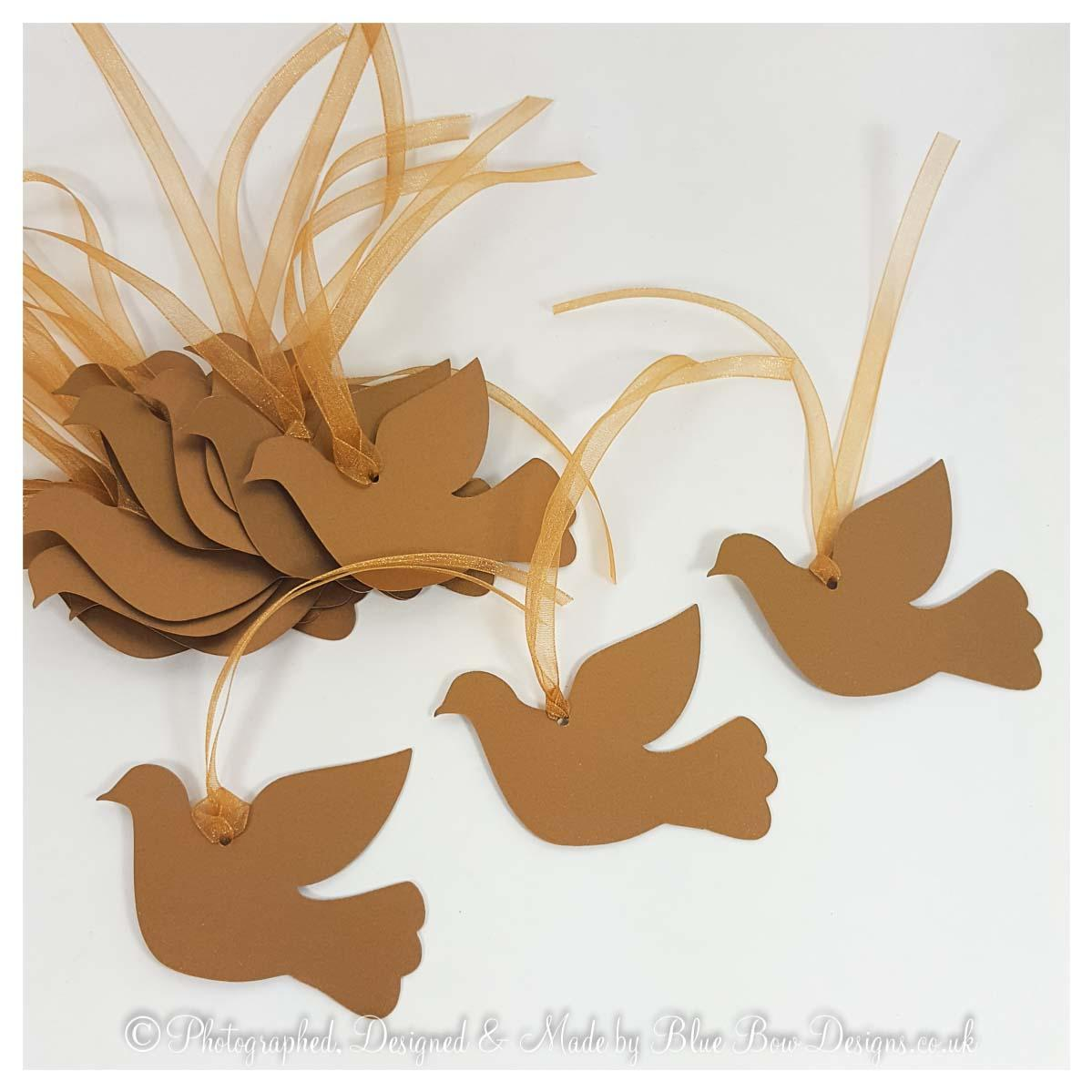 Dove shaped tags