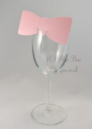 Pink bow tie place cards on wine glass