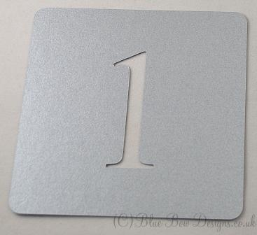 Silver stencil shaped table numbers