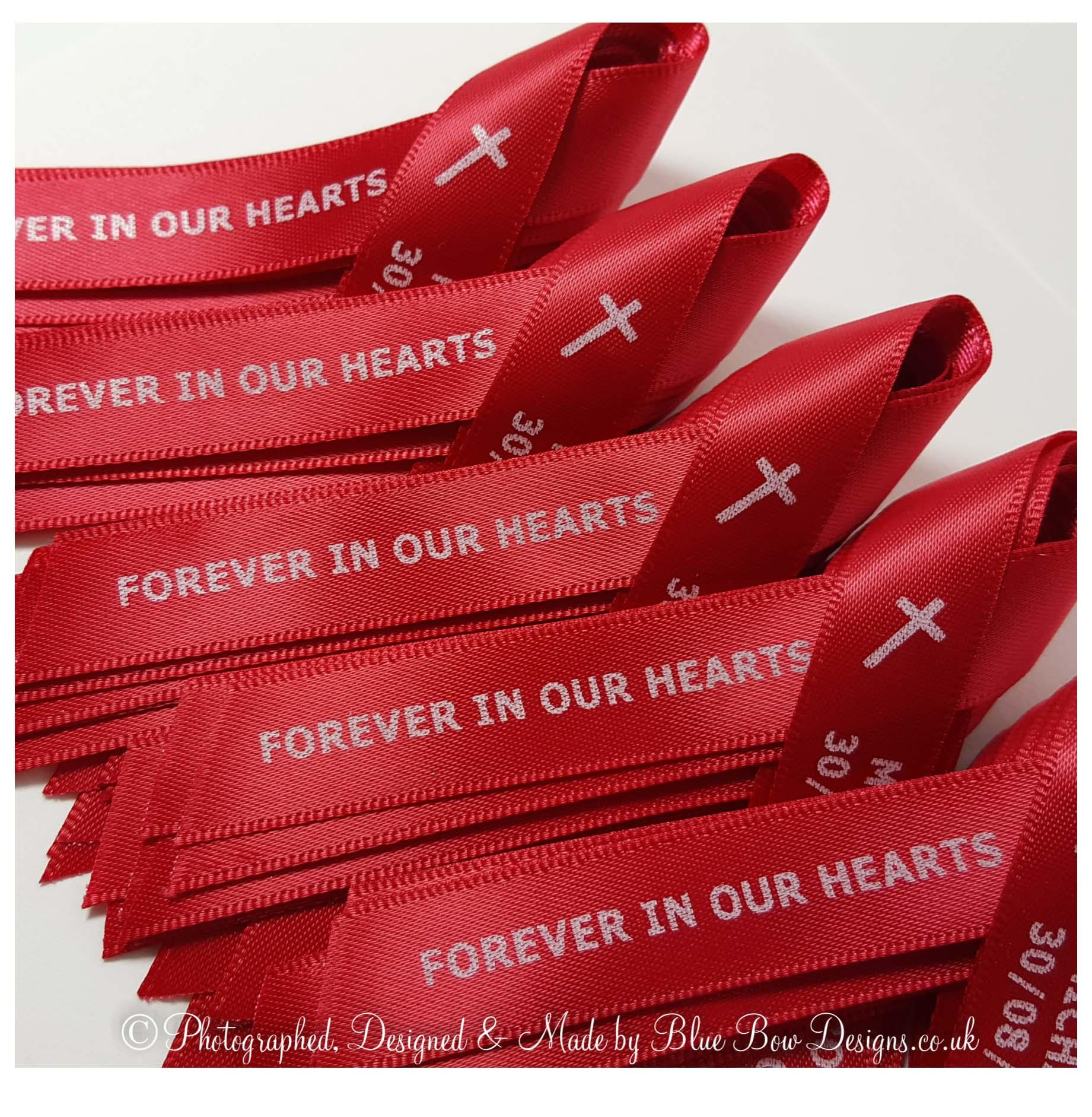 Red and white print funeral memorial ribbons