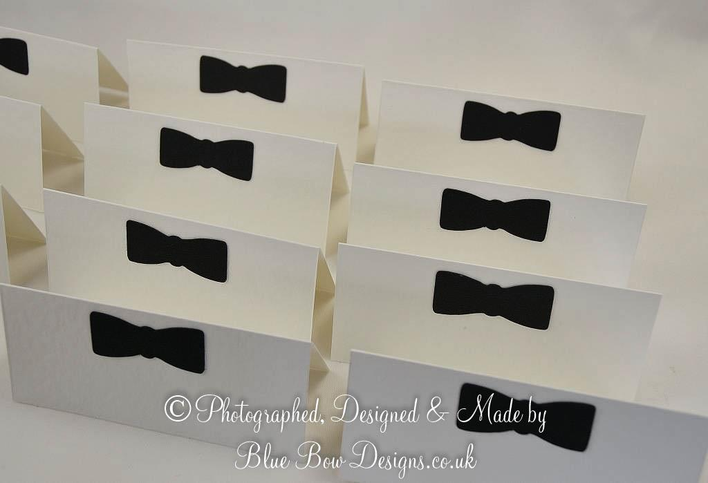 Black bow tie place cards on white card