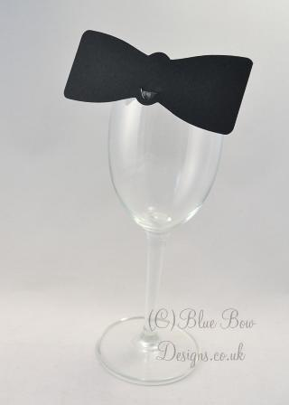 Black wine glass place card on wine glass