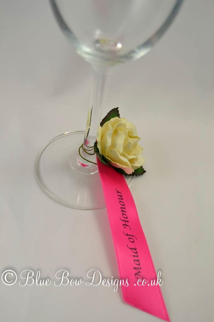 Personalised guest name rose. Fuchsia beauty ribbon