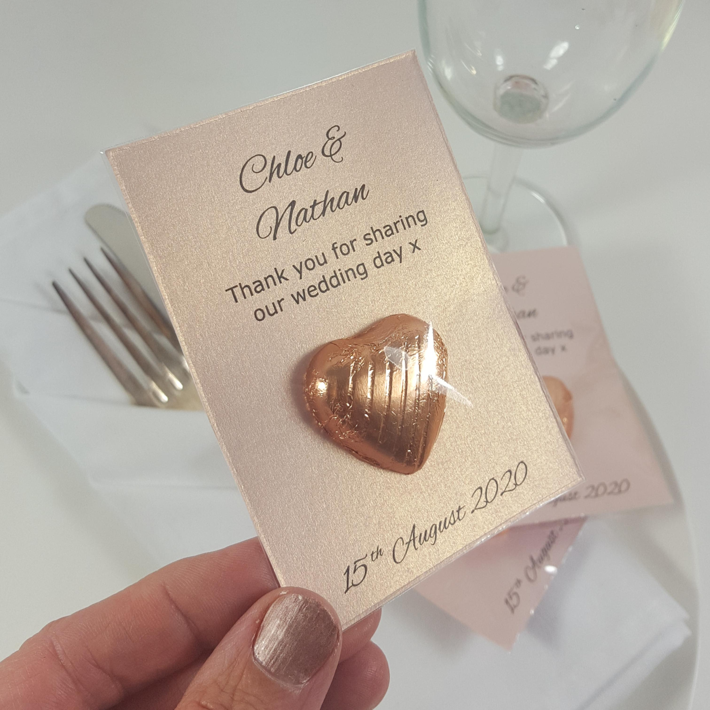 Rose gold chocolate  heart wedding favours on rose gold card