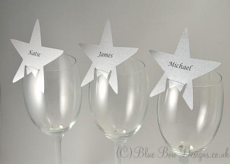 Silver stars for place cards with names printed