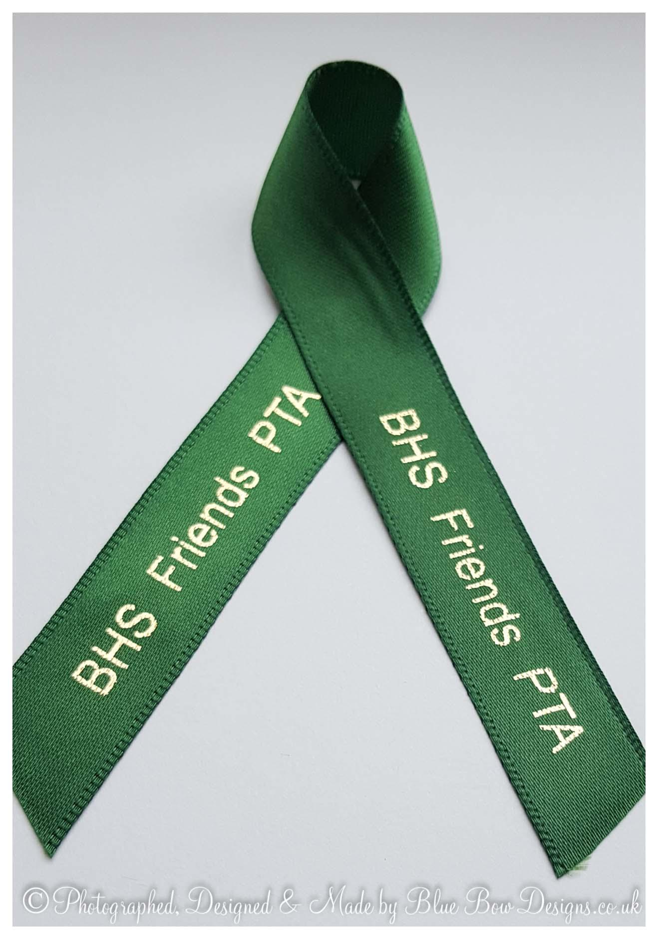 Emerald green and gold awareness ribbon