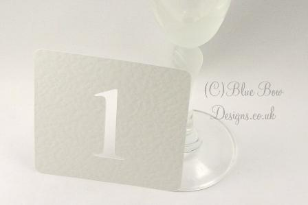 Ivory stencil shaped table numbers