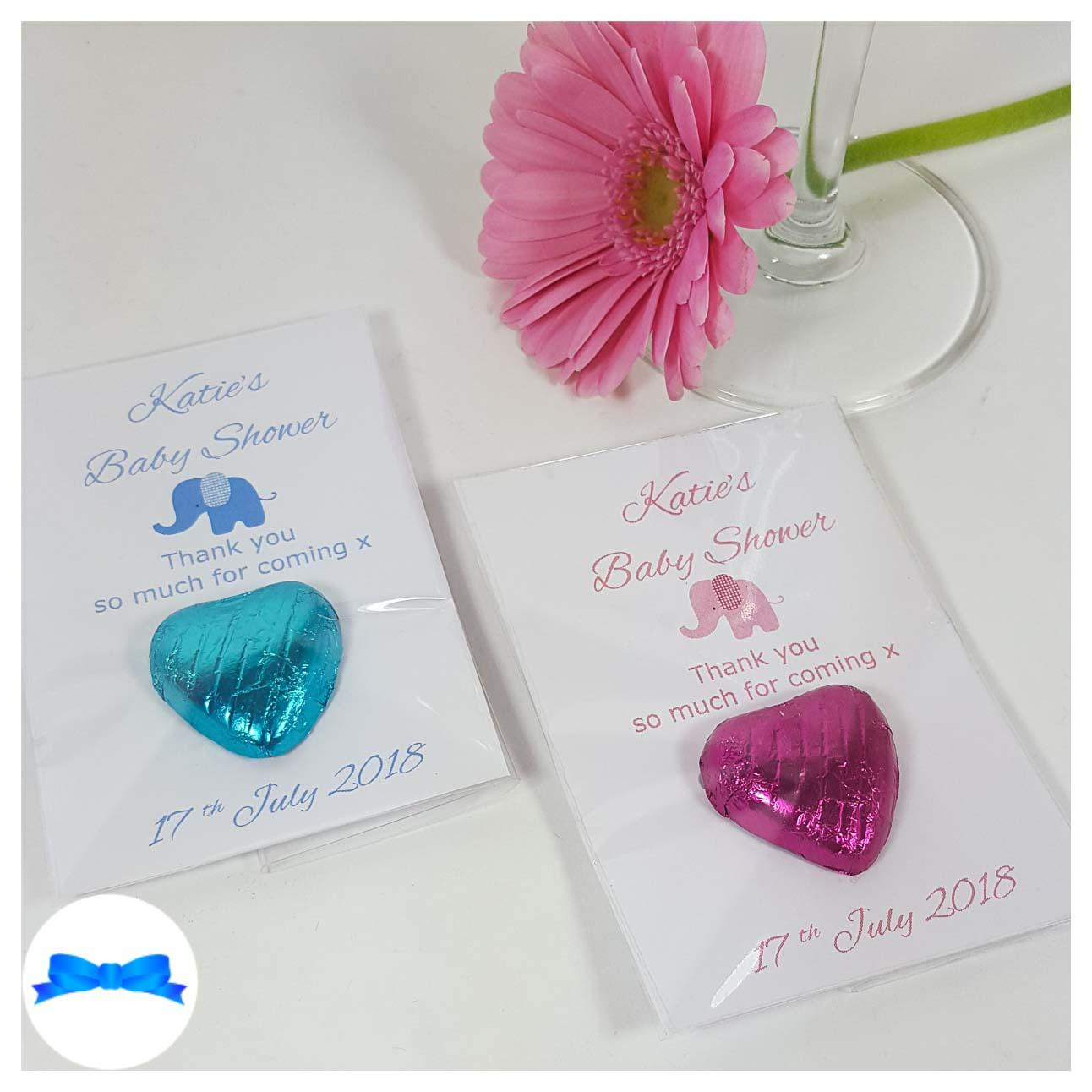 Baby shower chocolate heart favours with pink and blue toy elephants