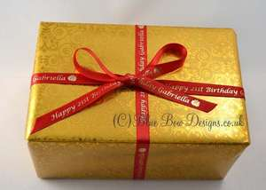 10 mm red and gold personalised ribbon on a gold present