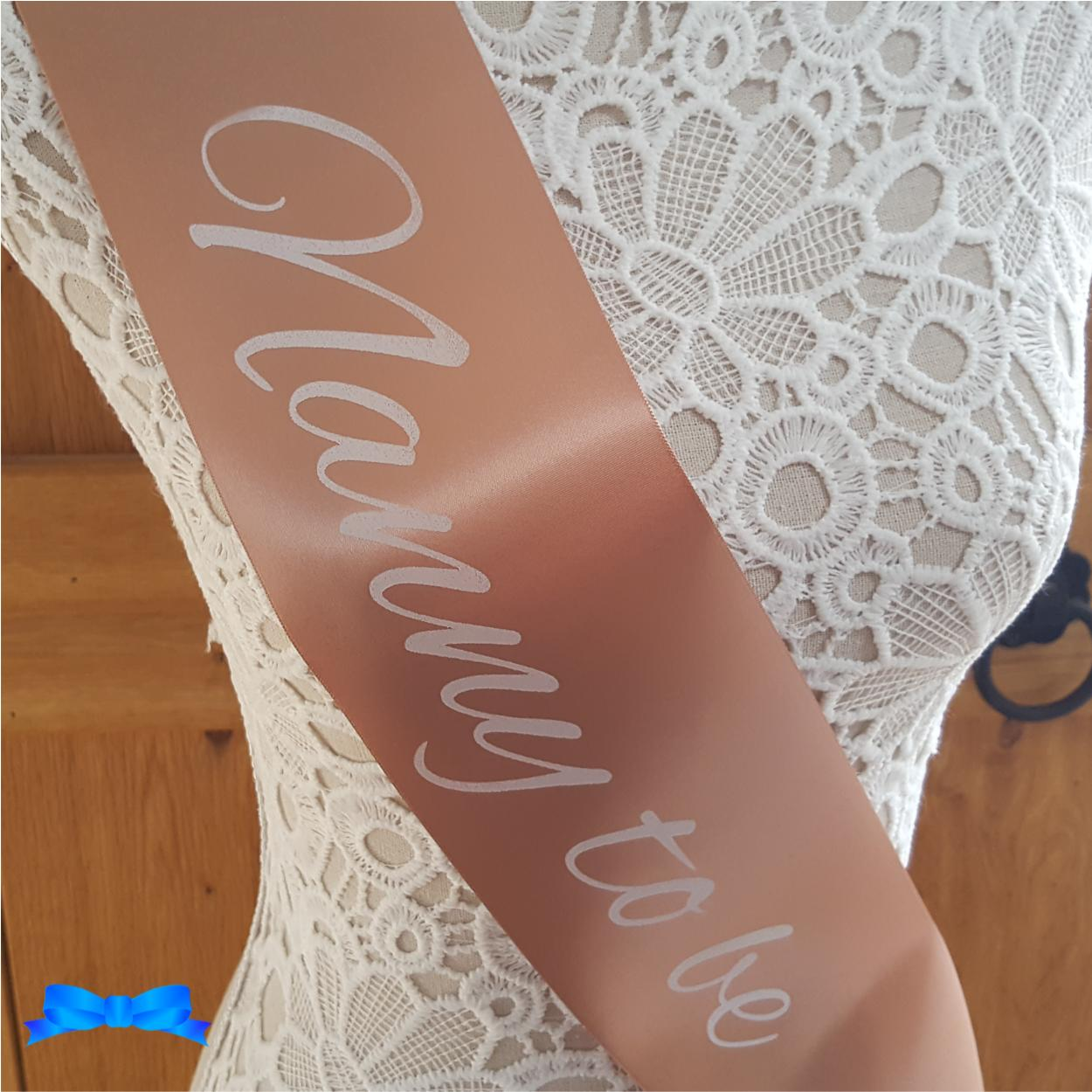 Personalised nanny to be rose gold sash with white text
