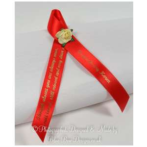 Red memorial ribbon with rose