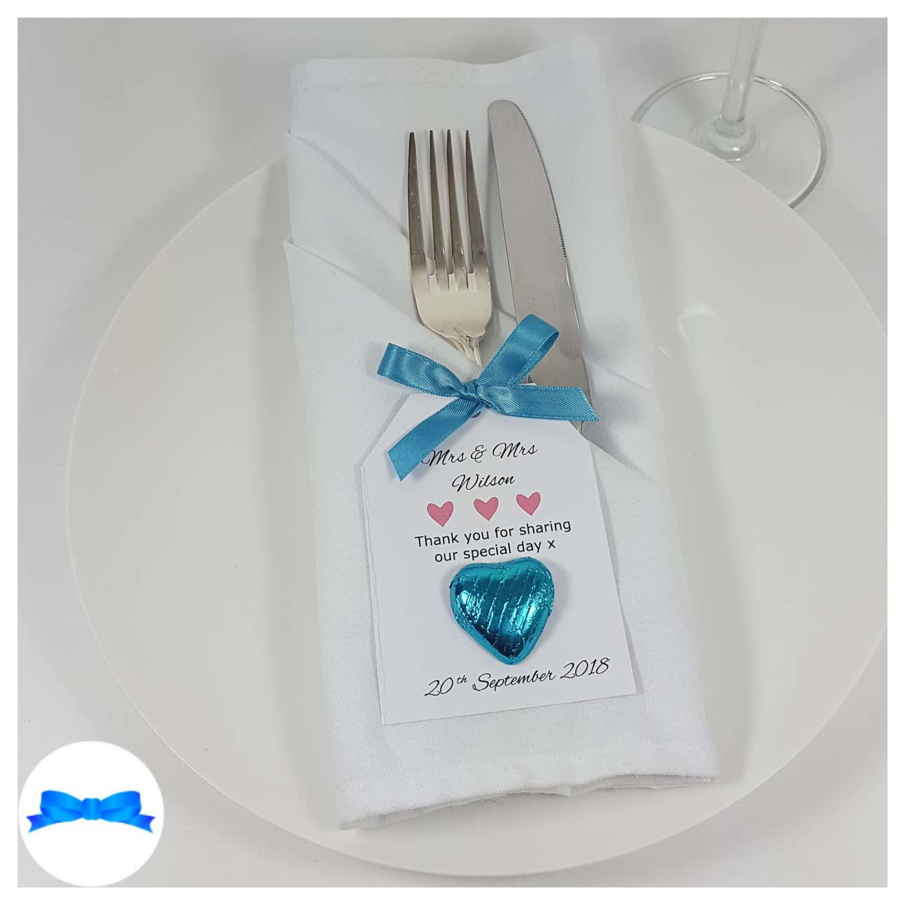 Wedding favour on a plate blue bow and favour