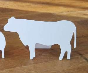 White cow shaped place card with back stand