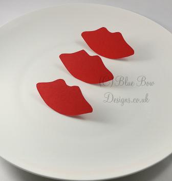 Red lip shaped place cards with back stands