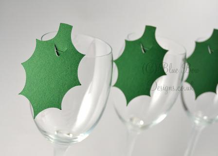 Green holly leaves for wine glass place cards