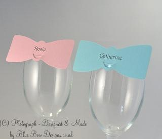 Pink and blue bow tie place cards