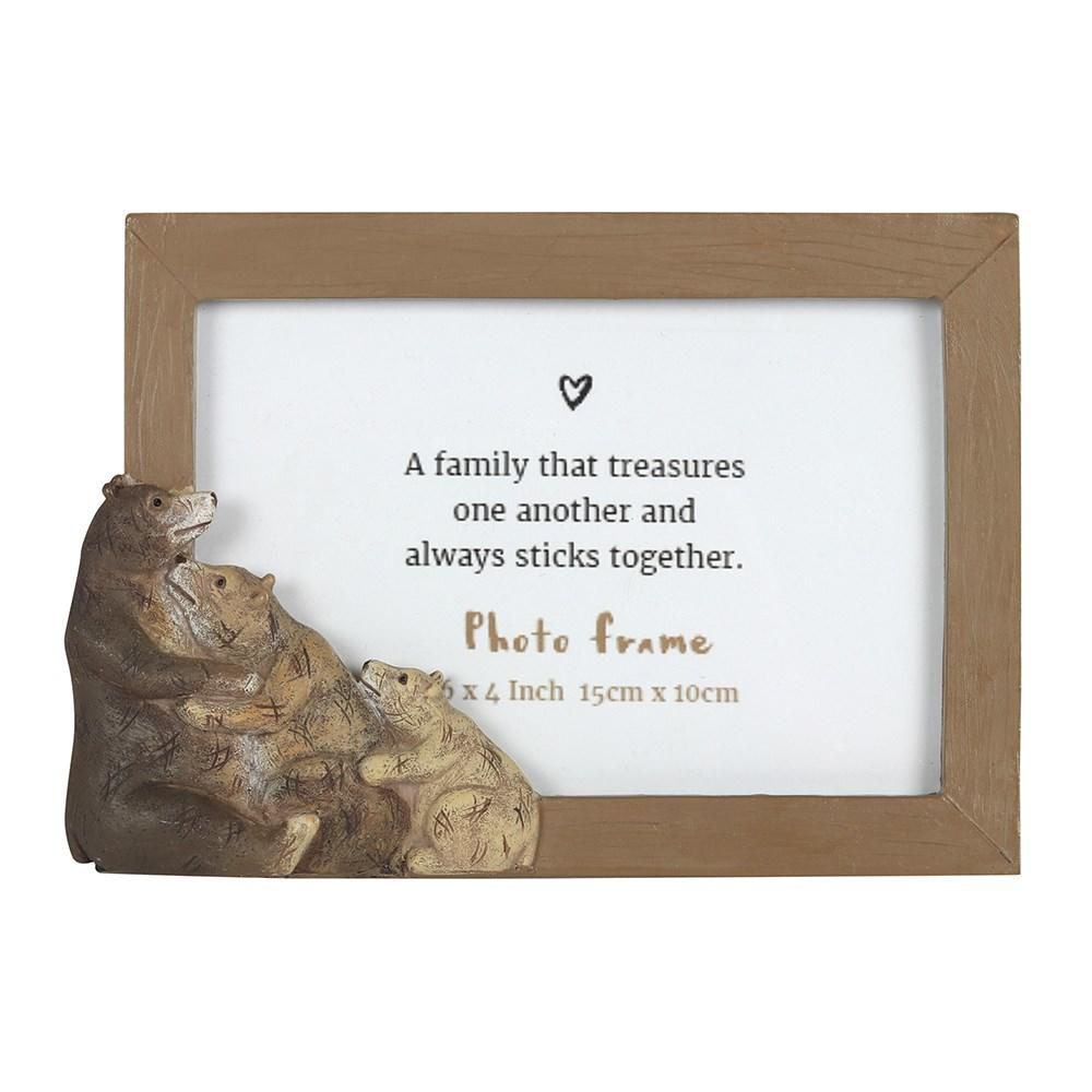 This adorable bear family photo frame is the perfect accessory for holding a picture of a treasured family moment. The frame holds a sweet sentiment which reads 'A family that treasures one another and always sticks together' which can be replaced with a standard 6x4 inch photograph.
