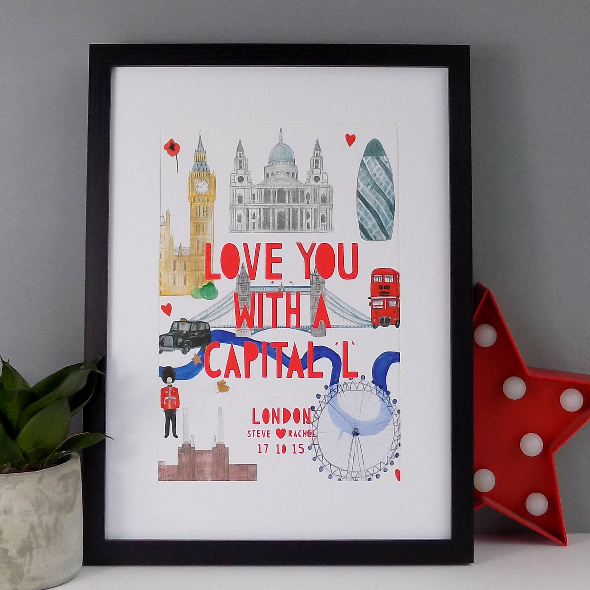Illustrated Watercolour London landmarks with a bright red papercut typographic text which says 'Love you with a capital L' and customised to the names of a couple and a special date.