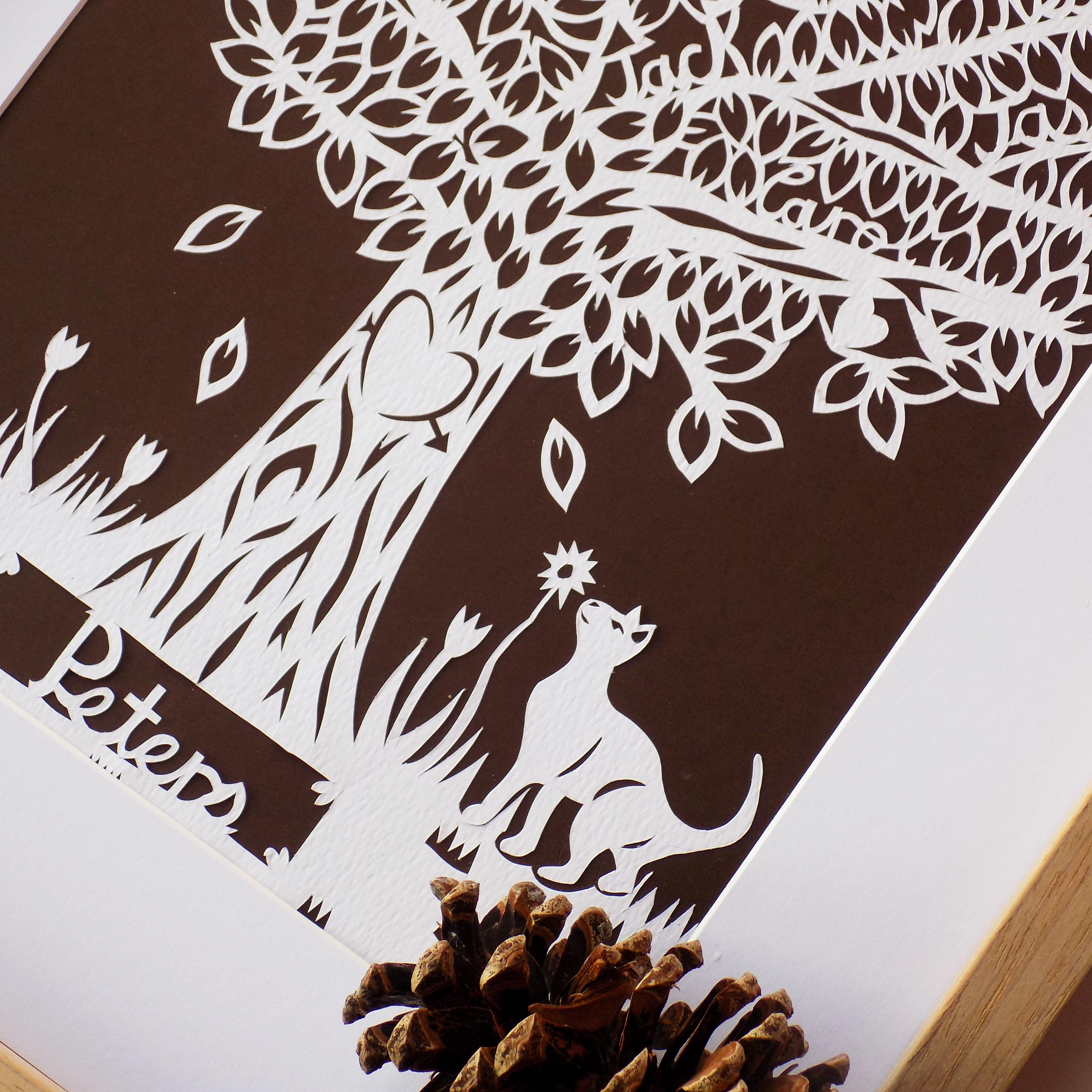 A second close up of a family tree paper cut