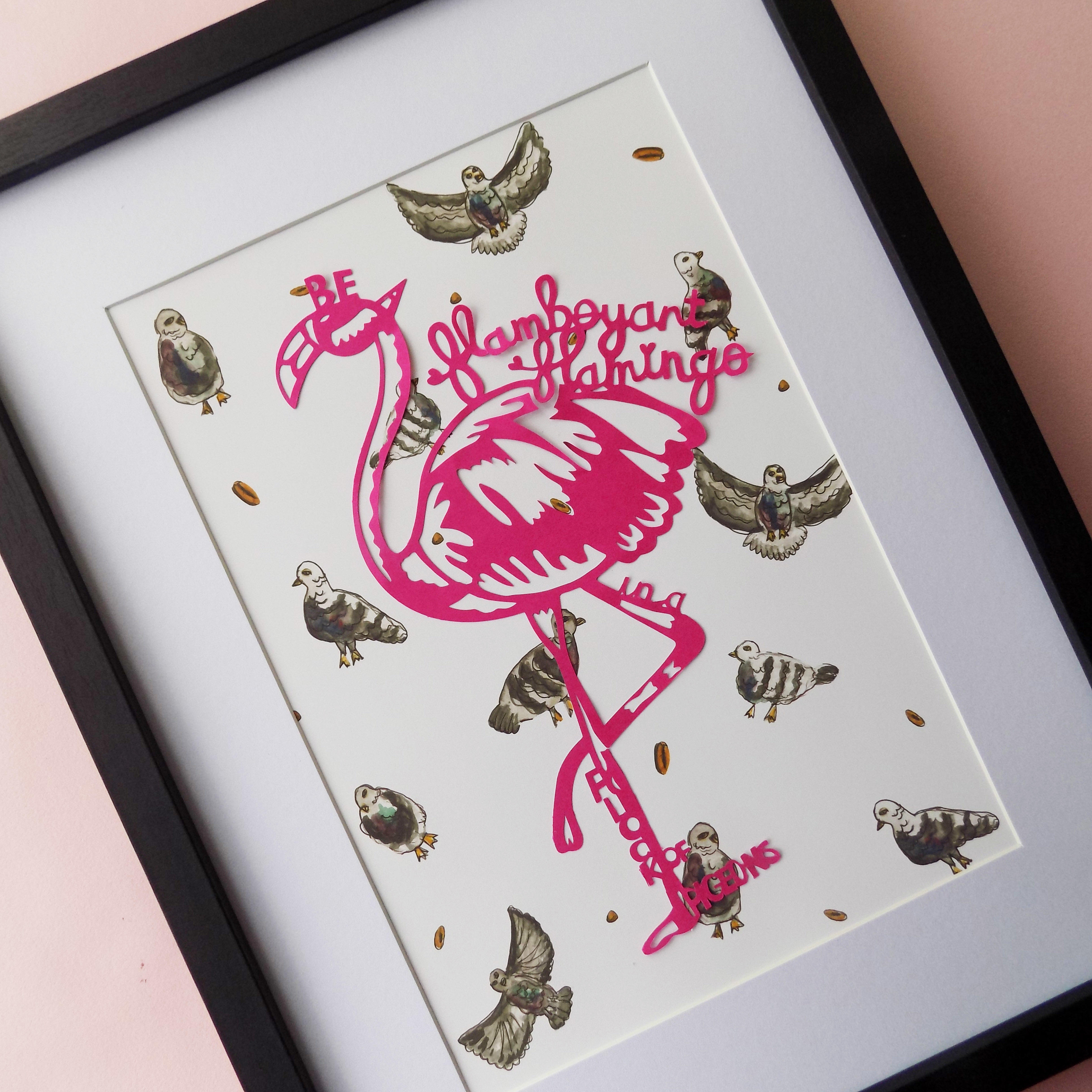 A close up of a paper cut flamingo