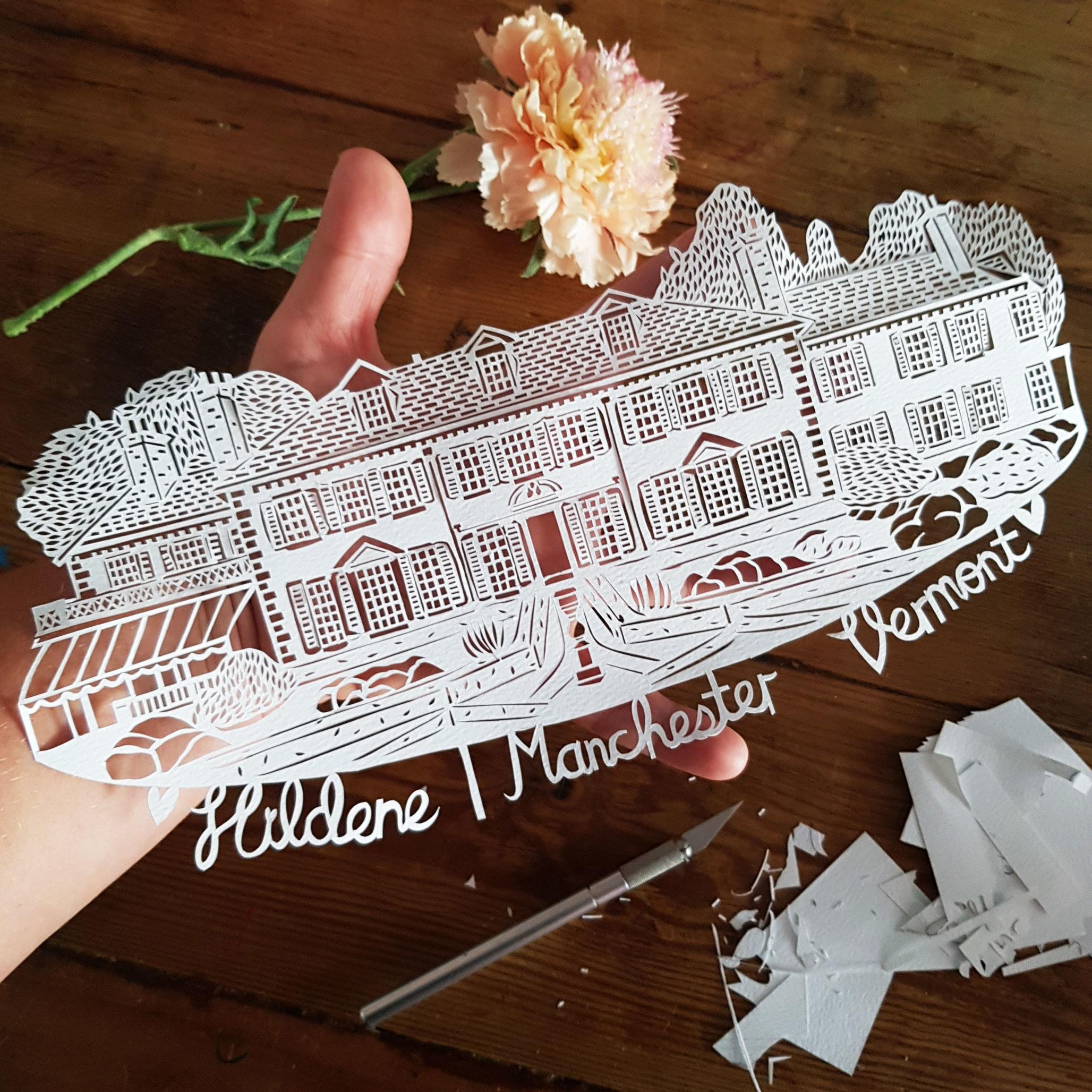 A paper cut of a venue with lots of details