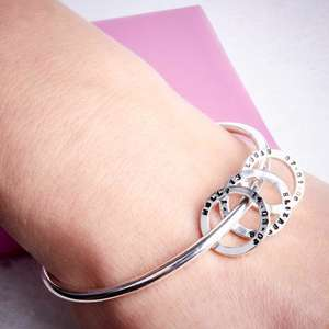 Handmade silver bangle with personalised silver beads by Emma White. Image property of THE JEWELLERY MAKERS