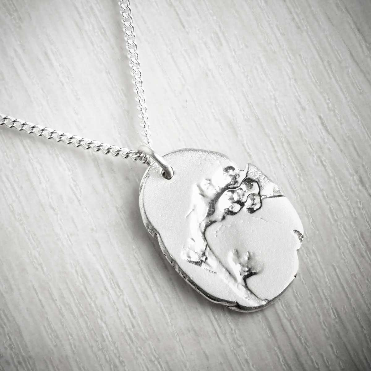 Forget-me-not September Fossil Pendant by Becca Macdonald. Image property of THE JEWELLERY MAKERS