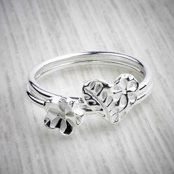Silver Clay Flower & Heart Stacking Rings by Elin Mair. Image property of THE JEWELLERY MAKERS.