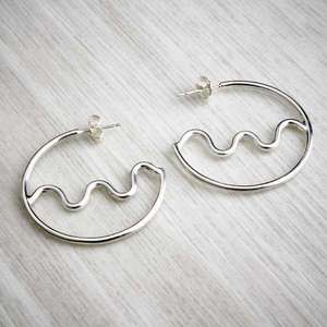 Cross Wiggle handmade silver hoops by Alice Chandler. Image property of THE JEWELLERY MAKERS