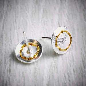 Handmade silver stud earrings sewn up with a circle of gold thread back view