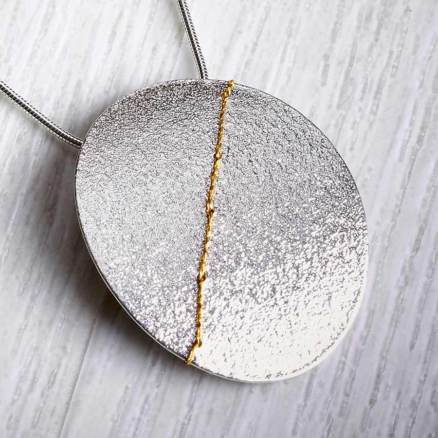 Silver and gold large oval necklace by Sara Buk