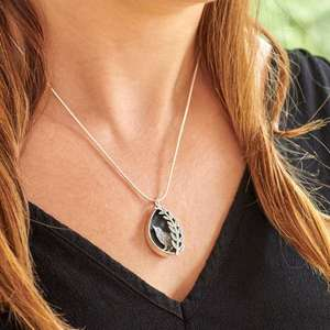 Silver Wren and Leaves Box Pendant by Helen Shere, worn on