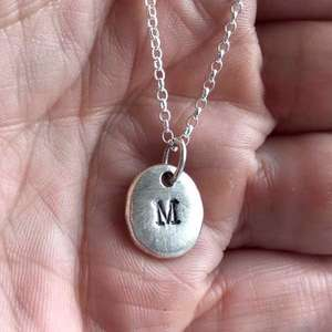 Silver Personalised Initial Necklace in the hand by Emma White